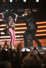 Finalists Irene and Johnson perform a medley on stage during the American Idol XIII 2014 Finale in Los Angeles