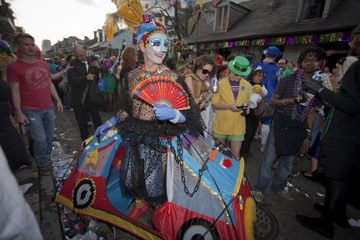 A reveler wearing tents as costume dances during Mardi Gras festivities in New Orleans