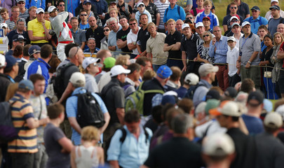 Adam Scott of Australia watches his tee shot on the 14th hole during the third round of the British Open golf championship at Royal Lytham & St Annes