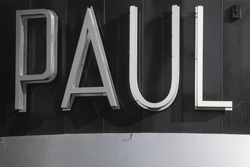 A Paul bakery logo is pictured on a building along the Lincoln Road Mall in Miami Beach