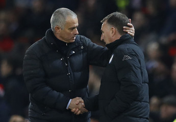 Wigan Athletic manager Warren Joyce and Manchester United manager Jose Mourinho at the end of the match