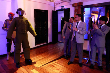 Models present bulletproof clothing by the Miguel Caballero Factory at the Chico Museum in Bogota, Colombia