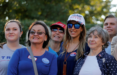 Supporters of Republican Presidential candidate Donald Trump pose for a picture with Eric Trump, son of Donald Trump at the Morrison Library as early voting continues in Charlotte