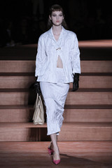 A model presents a creation by Italian designer Miuccia Prada as part of her Spring/Summer 2013 women's ready-to-wear fashion show for fashion house Miu Miu during Paris fashion week