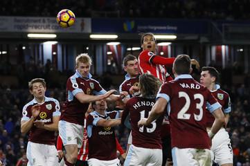Southampton's Virgil van Dijk in action with Burnley's Sam Vokes (C), Ben Mee (2nd L) and Michael Keane (R)