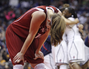 Stanford's Pedersen reacts as Connecticut players celebrate in the background in San Antonio