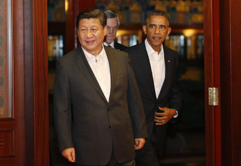 U.S. President Obama walks behind China's President Xi as they enter a room before a meeting at the Zhongnanhai leadership compound in Beijing