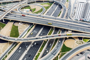 Scenic aerial view of big highway intersection in Dubai, UAE, at daytime. Transportation and communications concept.