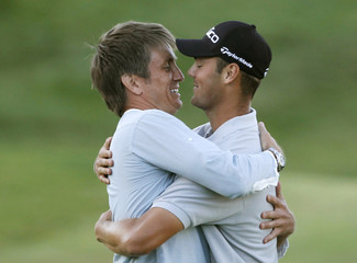 Kaymer of Germany hugs his manager after winning the playoff against Watson of the U.S. to win the 92nd PGA Golf Championship at Whistling Straits
