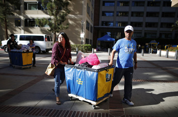 Microbiology, immunology and molecular genetics major Wang moves into her dorm with the help of her father Paul, along with other new UCLA students move into campus residence halls in preparation for the new school year, in Los Angeles