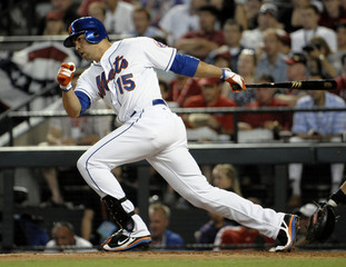 Beltran of the New York Mets hits a single in the fourth inning during Major League Baseball's All-Star Game in Phoenix