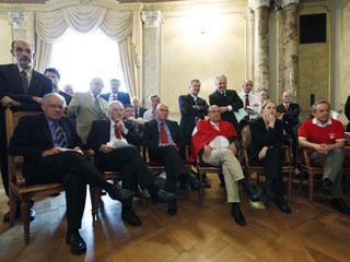 Swiss national councillors watch the World Cup 2010 soccer match between Switzerland and Spain on TV during the national council's summer session in Bern