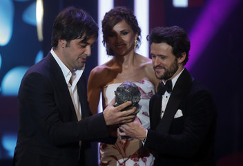 Producer Gilliber receives the Best European Film trohpy from Martin during the Spanish Film Academy's Goya Awards ceremony in Madrid