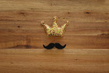 funny mustache and glitter crown. Father's day concept