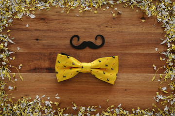 Top view image of funny mustache and bow tie. Father's day concept