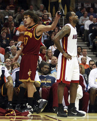 Cavaliers' Varejao removes the headband off Heat's James during the second half of their NBA basketball game in Cleveland