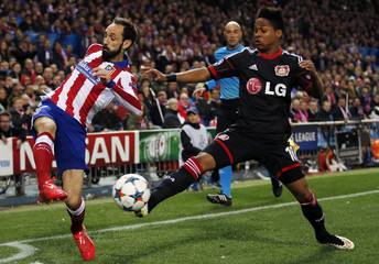 Atletico Madrid's Juanfran and Bayer Leverkusen's Wendell fight for the ball during their Champions League round of 16 second leg soccer match at Vicente Calderon stadium in Madrid