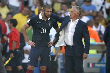 France's Karim Benzema reacts with team coach Didier Deschamps to their loss at the end of their 2014 World Cup quarter-finals against Germany at the Maracana stadium in Rio de Janeiro