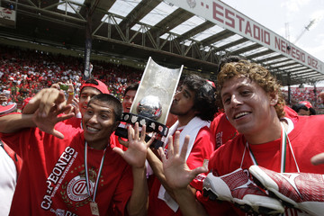 Toluca players celebrate with the trophy after defeating Santos in their Mexican league championship final at the Nemesio Diez stadium in Toluca
