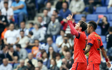 Barcelona's Neymar and Lionel Messi celebrate a goal against Espanyol during their Spanish first division soccer match near Barcelona
