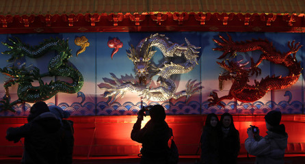 People take pictures of an installation during Chinese Lunar New Year celebrations in Prague