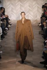 A model presents a creation by Belgium designer Martin Margiela as part of his Fall/Winter 2012-2013 women's ready-to-wear fashion show for Belgium fashion house Maison Martin Margiela in Paris