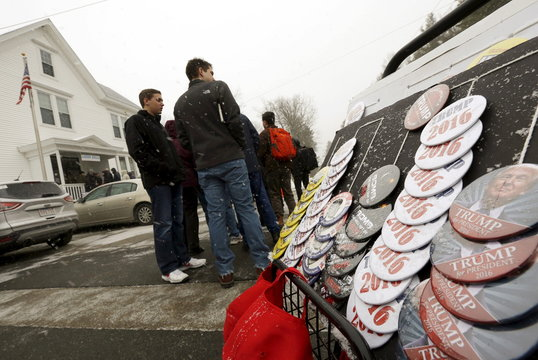 People stand in line as it snows to see Republican U.S. presidential candidate Donald Trump at a town hall presidential campaign event at the Lions Club in Londonderry, New Hampshire