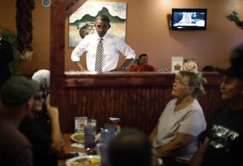 U.S. President Obama stops to speak to diners at Romero's Cafe in Pueblo