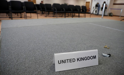 A United Kingdom name card lies on a stage inside the empty British press conference room on the second day of the EU Summit in Brussels