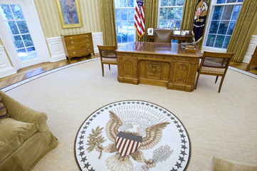 The Oval Office of Obama has a new seal in the carpeting, as well as new wallpaper and sofas at the White House in Washington