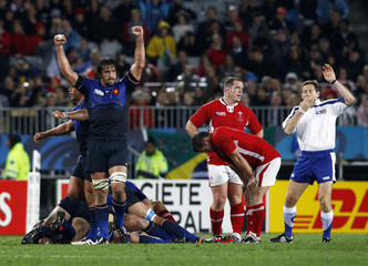 France's Julien Pierre celebrates as Wales players react after their Rugby World Cup semi-final match at Eden Park in Auckland