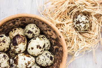 Quail eggs in the old wooden table