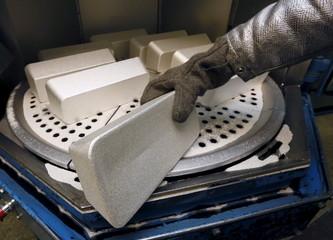 Employee places ingots of 99.99 percent pure silver before the machining process at the Krastsvetmet Krasnoyarsk non-ferrous metals plant in the Siberian city of Krasnoyarsk, Russia