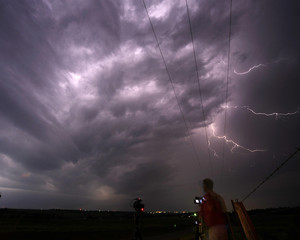 Storm chaser photographer Mack takes photos of lightning from a tornadic super cell near Apache City