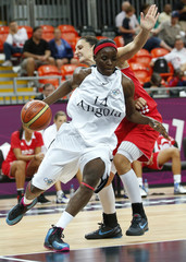 Angola's Nadir Manuel is challenged by Croatia's Ana Lelas during their women's basketball preliminary round, Group A match at the Basketball Arena during the London 2012 Olympic Games