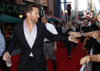 """Cast member Hugh Jackman high fives fans at the movie premiere of """"Real Steel"""" in Los Angeles"""