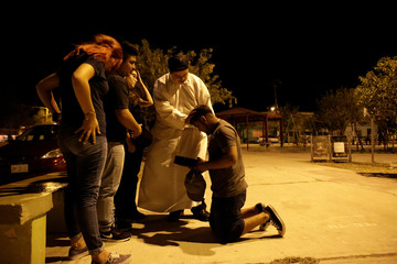 """The Wider Image: Aspiring priest brings youth to the """"Gang of Christ\"""