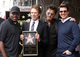 Actors pose with film and television producer Jerry Bruckheimer during ceremonies honoring Bruckheimer with a star on the Hollywood Walk of Fame