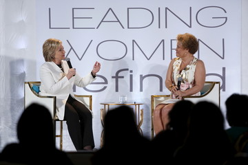 Clinton smiles as she takes part in an onstage interview with Lee at the BET Networks Leading Women Defined program in Bal Harbour, Florida