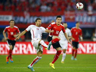 Junuzovic of Austria is challenged by Zverotic of Montenegro during their Euro 2016 group G qualifying match in Vienna