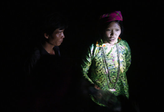 """Ethnic Giay woman and Nung man sing while attending the """"love market"""" in Khau Vai village in Vietnam's northern Ha Giang province, north of Hanoi"""