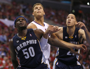 Los Angeles Clippers power forward Griffin is blocked out by Memphis Grizzlies power forward Randolph and Prince during Game 2 of their NBA Western Conference Quarterfinals basketball playoff series in Los Angeles, California