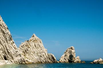Mediterranean seascape of Le Due Sorelle, famous beach of Conero, Marche Italy