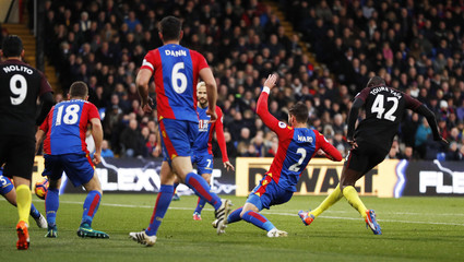 Manchester City's Yaya Toure scores their first goal