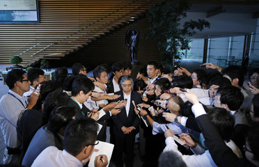 Bank of Japan Governor Haruhiko Kuroda speaks to the media after meeting with Japan's Prime Minister Shinzo Abe in Tokyo