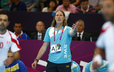 Sweden's coach Staffan Olsson reacts in their men's handball Preliminaries Group A match against Tunisia at the Copper Box venue during the London 2012 Olympic Games