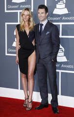 Adam Levine of Maroon 5 and his girlfriend Anne Vyalitsyna arrive at the 54th annual Grammy Awards in Los Angeles