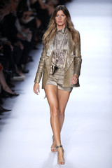 Brazilian model Gisele Bundchen presents a creation by Italian designer Riccardo Tisci for French fashion house Givenchy as part of his Spring/Summer 2012 women's ready-to-wear fashion collection in Paris