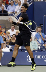 Rafael Nadal of Spain returns volley toTeymuraz Gabashvili of Russia during their first round match at the U.S. Open tennis tournament in New York