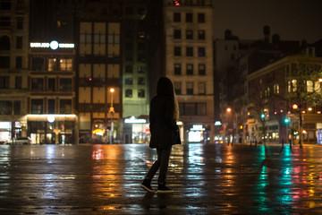 Girl walk night city after rain
